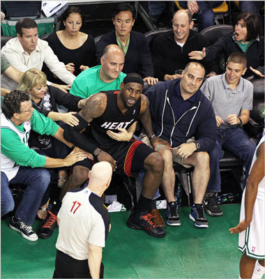LeBron James found himself seated on a fan as he looked for a call from referee Joey Crawford, which he didn't get in the fourth quarter.