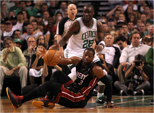 Dwyane Wade attempted to control his dribble as he fell to the court against Mickael Pietrus.