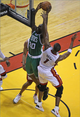 Celtics power forward Brandon Bass puts back a shot at the end of the first half.