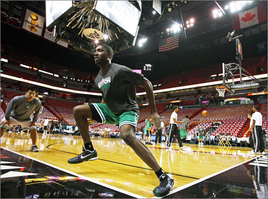 Under the watchful eye of Celtics strength and conditioning coach Bryan Doo (far left), Boston rookie guard E'Twaun Moore did some pregame agility drills. The Boston Celtics visited the Miami Heat for Game 5 of the Eastern Conference Finals at American Airlines Arena.