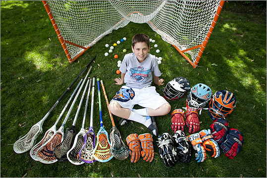 Kristopher Campbell, 13, of Longmeadow, who plays on two teams, displayed his collection of colorful lacrosse gear.