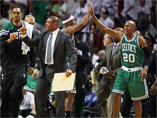 Doc Rivers was pumped, and Paul Pierce and Ray Allen celebrated at right as the final horn sounded in Boston's victory. After dispatching the Heat, 94-90, the Celtics headed back to Boston for Game 6 with a 3-2 series lead.