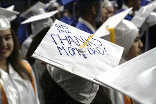 Held at the Tufts Unversity Gantcher Center, hundreds of parents, friends, and relatives packed the field house. One graduate dedicated her mortarboard to her parents.