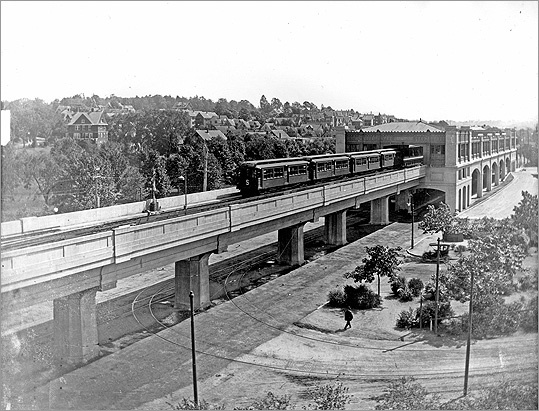 Pictured: Forest Hills Station on August 5, 1910. The train was leaving for Boston. The 'S' on the end of the first car indicates that it's a smoking car, set aside for smokers only.