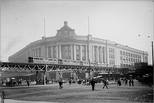 In 1901, before it turned into the Orange Line, the Boston Elevated Railway's first rapid transit train ran between Sullivan Square and Dudley Street stations. Boston was the fourth major city in the United States to get an elevated rapid transit system. Almost the entire route, except for an area outside the Tremont Street Subway (now Park Street Station), was made up of a two-track elevated structure. Pictured: The elevated line at South Station.