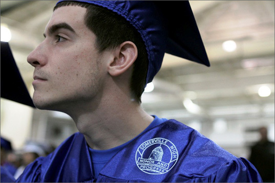 Tyler Holmes, 18, listens as school headmaster Anthony Chiciarello welcomes the graduates.
