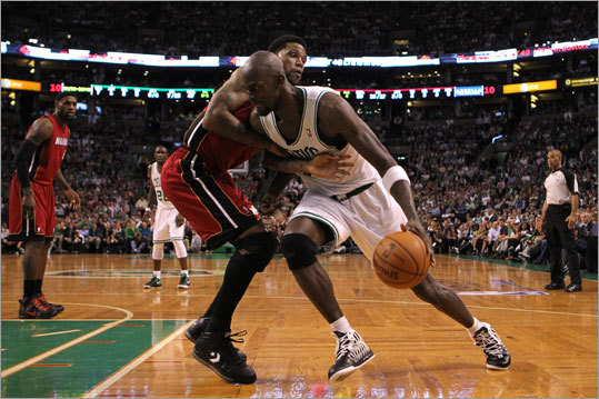 Kevin Garnett worked against Udonis Haslem in the first half.