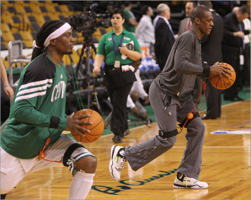 Celtics Marquis Daniels and Rajon Rondo used training bands as the stretched prior to the start of Game 6.