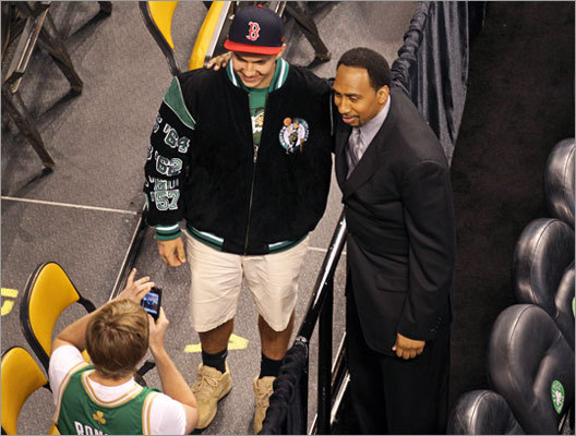 ESPN analyst Stephan A. Smith posed for a photo with a Celtics fan at TD Garden.