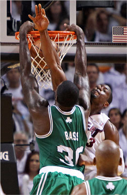 Brandon Bass dunked over Miami's Dwayne Wade late inthe second quarter.