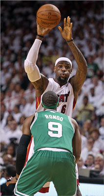 LeBron James passed over the defense of Rajon Rondo in the first quarter.