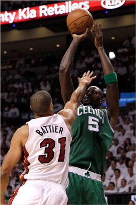 Kevin Garnett shot over Shane Battier in the first quarter.