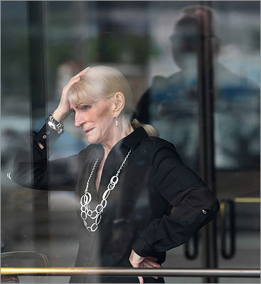 The sister of an alleged Bulger victim stood inside the doorway of the courtroom entrance holding her head with her hand.