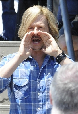 Co-star David Spade talks to the crowd in between takes.