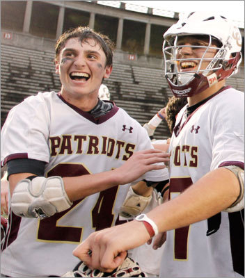Div. 2 boys lacrosse Concord-Carlisle's Nick Brozowski, left, and Tyler Koning celebrated after win the Division 2 EMass final at Harvard. Concord-Carlisle went on to win the state championship against Algonquin 13-3. Story: Concord-Carlisle cruises to victory
