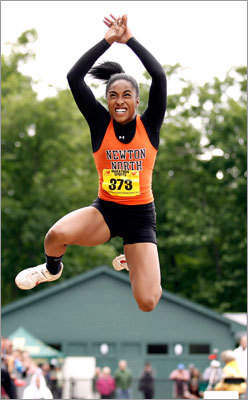 Girls track & field all-state Newton North's Carla Forbes won the triple jump and the long jump at the all-state track & field championships at Fitchburg State. She helped propel her school to win the state title. Story: Newton North's Carla Forbes soars high
