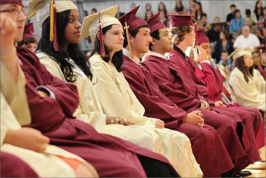 Mystic Valley Regional High The procession and invocation were delivered by Rev. Gerald Whetstone of the First Church of the Nazarene. At left, graduates listening during introductory remarks.