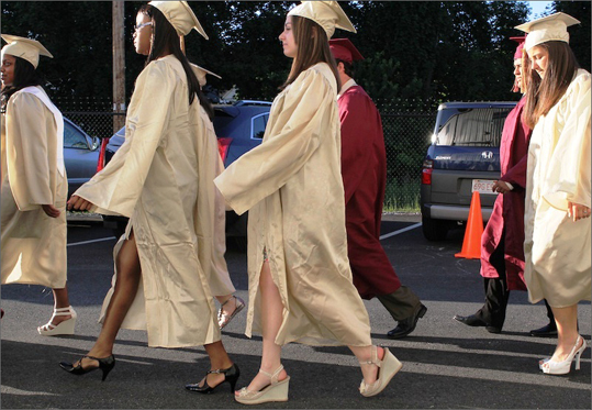 Mystic Valley Regional High An overwhelming 94 percent of the class of 2012 will be attending a four-year college in the fall. At left, students made their way toward the gymnasium entrance, their last walk as Mystic Valley Regional Charter School seniors before graduating.