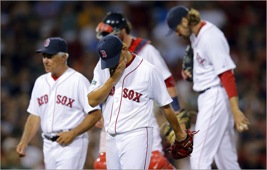 June 21: Red Sox 6, Marlins 5 Red Sox pitcher Daisuke Matsuzaka walked off the mound after being taken out of the game by manager Bobby Valentine for pitcher Andrew Miller in the sixth inning.