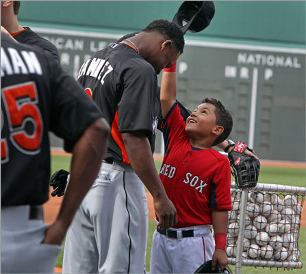 June 19: Red Sox 7, Marlins 5 Miami's Hanley Ramirez (left) had his hat pulled off by D'Angelo Ortiz (right), the son of the Red Sox David Ortiz (not pictured) during batting practice.