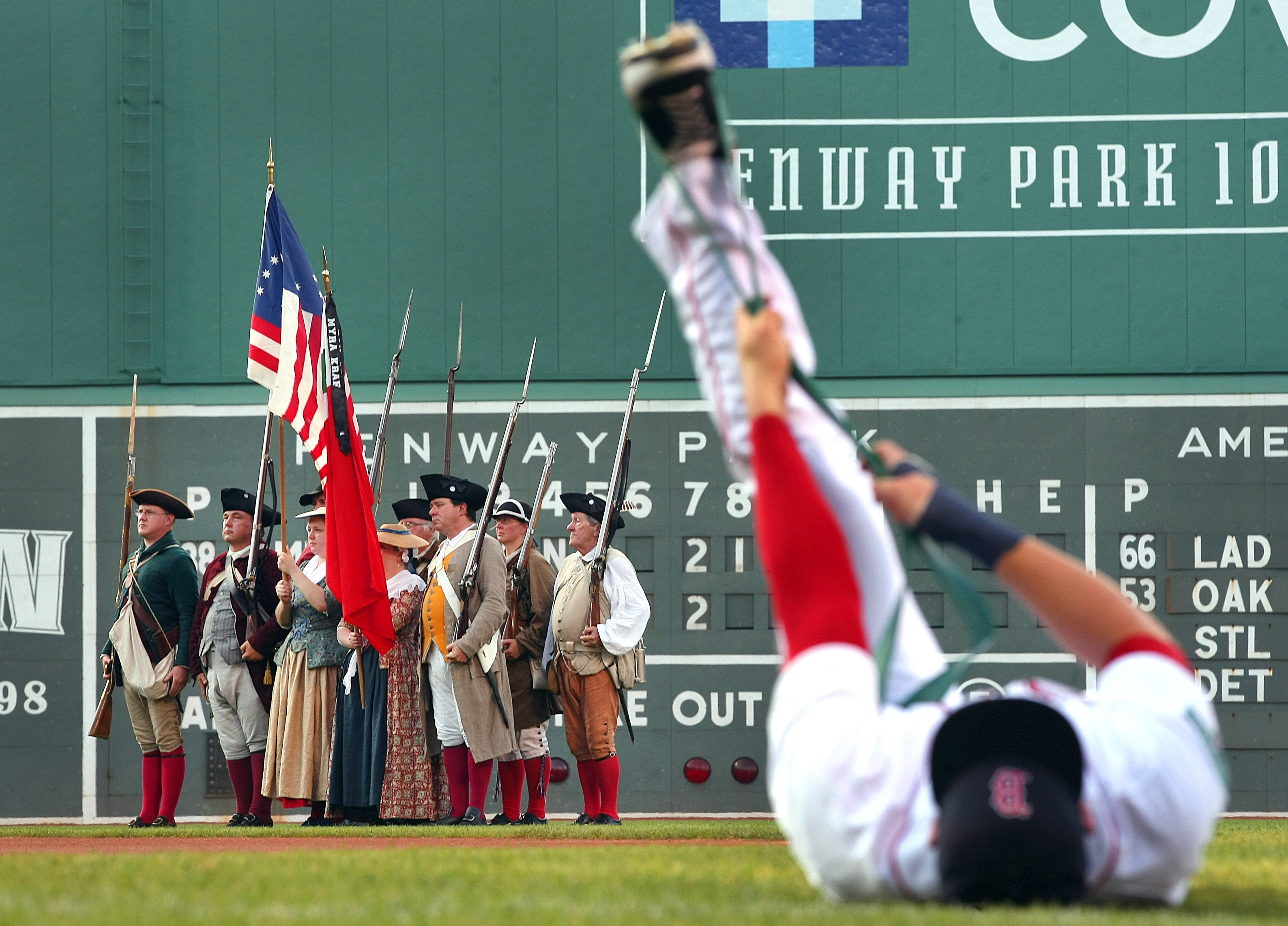 June 21: Red Sox 6, Marlins 5 Red Sox center fielder Ryan Kalish stretched before the game as Revolutionary War militia line the outfield waiting for the start of the national anthem.