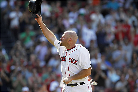 With his trade to the White Sox soon to be official, Kevin Youkilis left the field for a pinch runner in the seventh inning and saluted the cheering Fenway crowd.