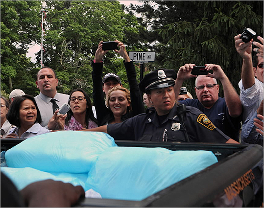 Once the bear was on the ground, officials gave it a second tranquilizer shot before it was placed in 480 pounds of ice shavings picked up from Brookline Ice and Coal. When a bear is tranquilized, its body temperature rises and that may endanger the animal's health, said Reggie Zimmerman, spokesman for the Massachusetts Executive Office of Energy and Environmental Affairs.