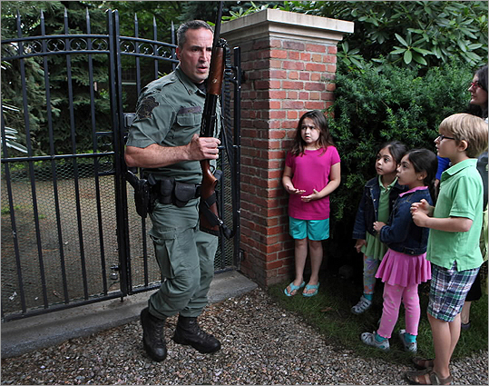 Officer Matt Nardi, with the Massachusetts Environmental Police, left the yard where the bear fell in Brookline.