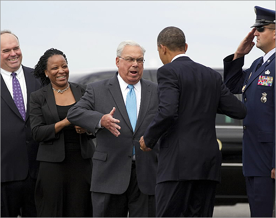 President Obama was greeted by Boston Mayor Thomas M. Menino as he stepped off Air Force One at Logan Airport.