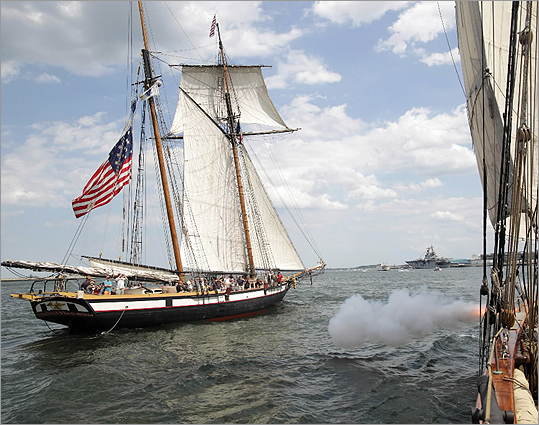 Aboard the 1812 era ship the Pride of Baltimore II, gunner Frank Bell fired blank rounds from a replica smoothbore gun at the Privateer Lynx during a battle reenactment in the Boston Harbor on July 1.