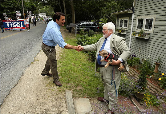 Republican congressional candidate Richard R. Tisei greeted Joe McDonough and dog Spunky in Newbury last month.