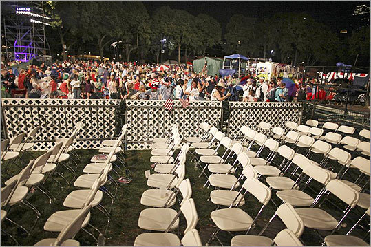 Audience members cleared out of the reserved section of the Esplanade oval after event officials postponed the concert due to the threat from a passing thunderstorm.