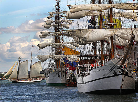 The tall ships Guayas, front, and Gloria are readied for departure after Boston's Fourth of July celebrations.