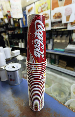 Soda Following New York City's footsteps, Cambridge is considering limiting the size of sodas in restaurants . Reasoning : Cambridge Mayor Henrietta Davis proposed the idea due to the health risks caused by consuming too much soda.