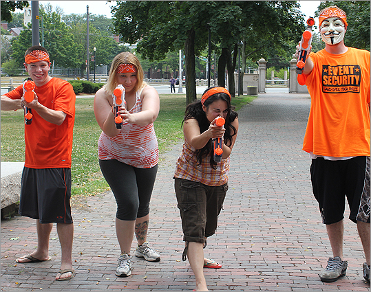 From left: Adam Balvlesc, 28, of Ayer, Cristal Bailey, 26, and Vanessa Vasquee, 31, both of Lowell, were all representing the Orange Line. 'Water fight in the middle of the day? Why not?' Balvlesc asked.