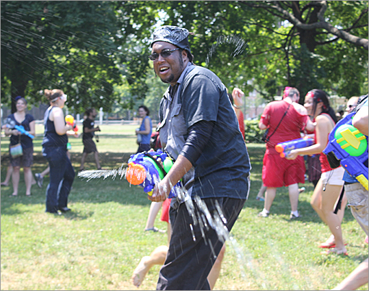 Unregular Radio's Lifestyle Show host Pat, of Boston, participated in the Water Gun Fight for the second time. 'It is so hot outside, why stay inside? This is a great way to stay cool and have fun,' Pat said.