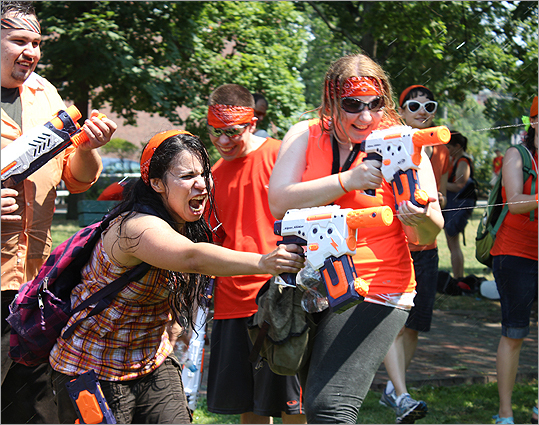 Vanessa Vasquee, 31, of Lowell (left), fought bravely at the Water Gun battle. 'This event is different from any other event. I wanted to be a part of something unique like this,' she said.