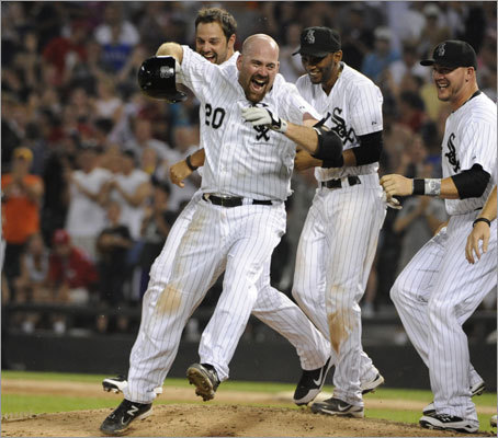 2012 Youkilis enjoyed the change of scenery, hitting .316 in his first three weeks with the White Sox compared to .233 in three months with the Red Sox. He also had a walk-off hit on the Fourth of July (left).