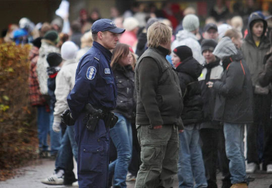 8 killed in Tuusula, Finland -- Nov. 7, 2007: After revealing plans for his attack in YouTube postings, 18-year-old Pekka-Eric Auvinen killed eight at his high school. Pictured: An armed policeman stood in front of the high school school as pupils returned to class days after the shooting.