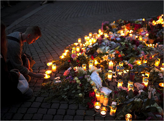 77 killed in Oslo -- July 22, 2011: Confessed mass killer Anders Behring Breivik killed 77 in Norway in twin attacks: a bombing in downtown Oslo and a shooting massacre at a youth camp outside the capital. The self-styled anti-Muslim militant admitted both attacks. Breivik was sentenced on Aug. 24 to 10 to 21 years in prison. Pictured: A youth lit a candle next to the Domkirke church to pay tribute to victims of the twin attacks in central Oslo.