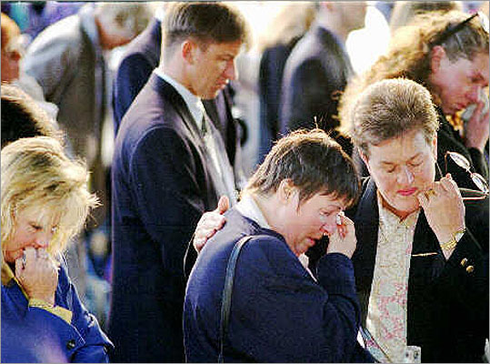 35 killed in Tasmania, Australia -- April 28, 1996: Martin Bryant, 29, burst into cafeteria in seaside resort of Port Arthur, shooting 20 people to death. Driving away, he killed 15 others. He was captured and imprisoned. Pictured: Mourners wept outside St. David Cathedral in Hobart, Tasmania, during memorial service for Port Arthur shooting massacre victims.