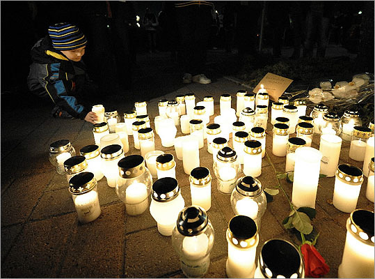 10 killed in Kauhajoki, Finland -- Sept. 23, 2008: Matti Saari, 22, walked into a vocational college and opened fire, killing 10 and burning their bodies with firebombs before shooting himself fatally in the head. Pictured: A boy laid a candle in the evening at the school.
