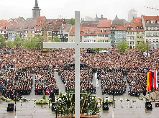 16 killed in Erfurt, Germany -- April 26, 2002: Robert Steinhaeuser, 19, who had been expelled from school killed 13 teachers, two former classmates and a policeman, before committing suicide. Pictured: Thousands of Germans attended an open air memorial service outside the cathedral of the eastern German city of Erfurt to mourn the victims of the shooting, which was the country's worst post-war massacre.