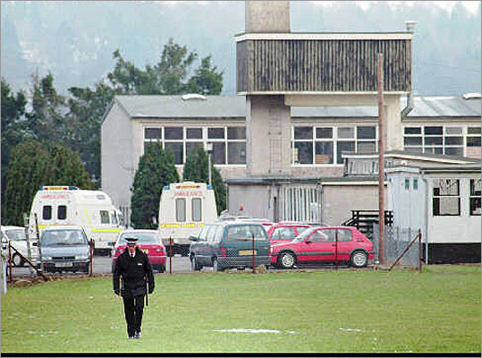 16 killed in Dunblane, Scotland -- March 13, 1996: Thomas Hamilton, 43, killed 16 kindergarten children and their teacher in an elementary school then killed himself. Pictured: A police officer walked on the grounds of the Dunblane Primary School.