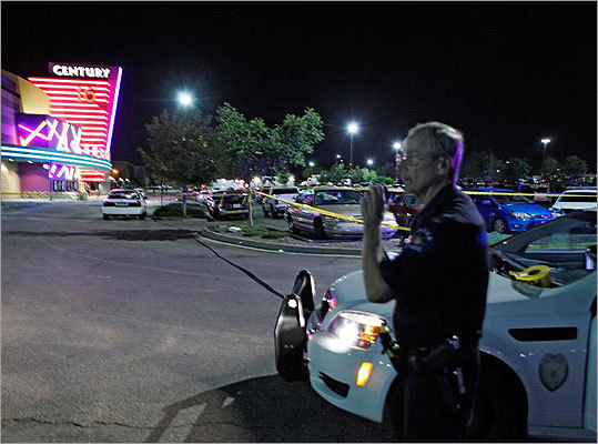 An Aurora police officer talked on his radio outside of the theater where the shooting took place.