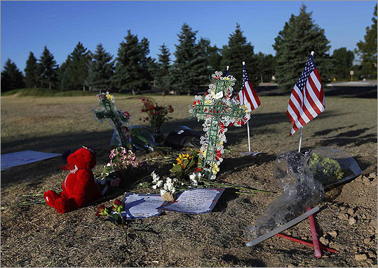 A memorial was made for victims on a hillside behind the theater where a gunman opened fire on moviegoers in Aurora, Colo.