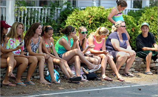 "Day after day, a gaggle of teenagers wearing bikinis and swim trunks have strategically stationed themselves on Marshfield's Bay Avenue in the hopes of catching a glimpse — or better yet, an iPhone snapshot — of Steve Carell, Rob Corddry, AnnaSophia Robb, or any of this season's star-quality visitors. The actors are appearing in ""The Way, Way Back,"" a movie being shot in various South Shore locations. Local fans don't have much time left for gawking, however; filming is scheduled to wrap up this Friday. Onlookers get to see extras and crew at a Movie production being filimed in Marshfield's Green Harbor neighborhood ."