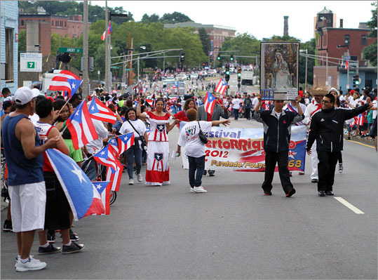 Roxbury and Jamaica Plain were awash with red, white, and blue Sunday as Boston's Puerto Rican community held its annual Puerto Rican Day Parade.