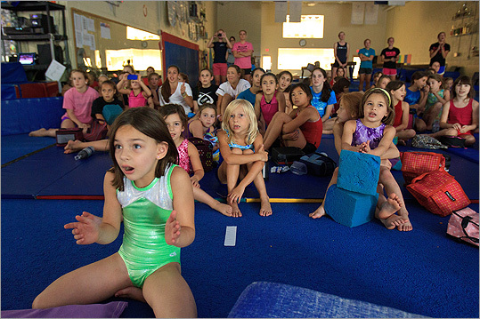 Many young gymnasts watched the US women's team compete in the gymnastics tournament Excel Gymnasium in Newton, where Raisman trained as a little girl. Jacquelyn Dupre-Honda, 6, of Brookline, watched a live-stream of the Olympics as team USA competed and won the gold medal in gymnastics.