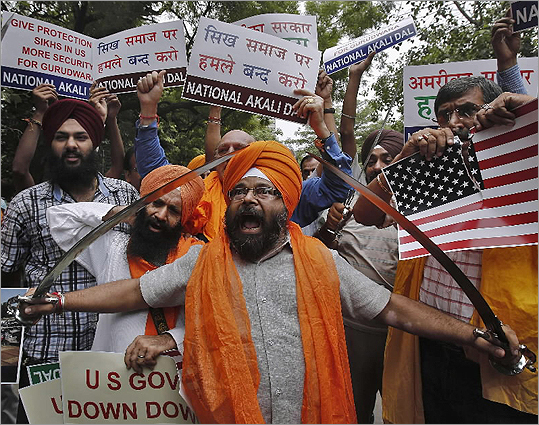 Activists from National Akali Dal, a regional Sikh political party, held swords and shouted slogans during a protest in New Delhi on Aug. 6 against the shooting at a Sikh temple in Wis.